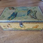 "from Rosemary: ""early 1900's butterfly motif tin candy box manufactured by the Artstyle Chocolate Company of Boston and St. Louis.  My mother's cousin gave this to me when I was a child to keep my sewing in."""
