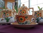 "from Pat: coffee set given to my mother before her wedding in 1937. It held a place of honor in her china cabinet. The bottoms of the cups, plates, and saucers say ""hand painted Japan."""