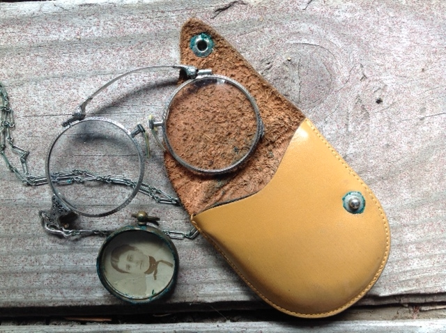 "from Lucia: ""leather case containing great aunt's reading glasses with photo"""
